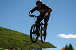 Mountain Biker Over Grass