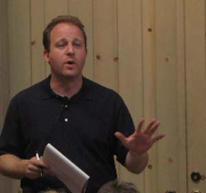 U.S. Rep. Jared Polis works the crowd in Edwards Wednesday.