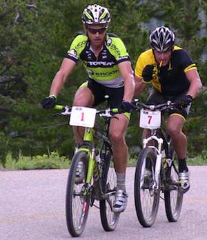 Seven-time Tour de France champion Lance Armstrong rides behind Gunnison's Dave Wiens during the Leadville 100 mountain bike race last year. Armstrong placed second behind Wiens, but hopes to improve on that result Saturday.