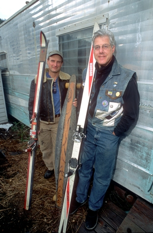 Arlan Moore, left, and Phil Horsman show off the long boards they used for ridiculous aerials during the glory days of the later outlawed Ravinos ski gang in the 80s.
