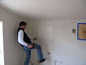 The author engages in some demolition of his own in the former editor's suite in the old Vail Daily offices in Crossroads.