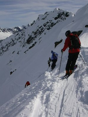 <strong>ON THE EDGE </strong>Skiers eye their line on a 40-degree pitch deep in the Chugach Mountains of Southeastern Alaska.