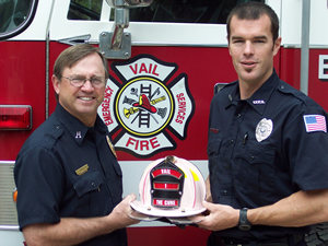Vail firefighters Cooter Overcash and Ryan Sutter show off the pink helmet they'll be auctioning at Friday's Celebration of Life Luncheon to benefit the Vail Breast Cancer Awareness Group.