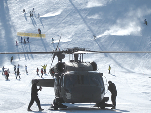 A crystal clear bluebird day made for a picture perfect landing by the National Guard who were invited to land their Black Hawk helicopter at the top of the Centennial Express Lift at Beaver Creek to kick off National Safety Awareness Week. Members of Beaver Creek's Ski Patrol and their Avalanche Rescue Dogs along with the National Guard crew members talked to skiers and snowboarders about skier safety and back country awareness. The Black Hawk crew allowed members of the public to sit in the helicopter and take photos.