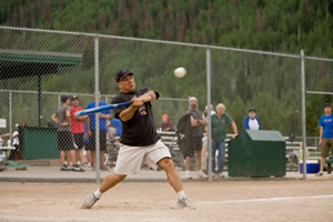 Joseph Alessi, Principal Trombone of the New York Philharmonic, swings for the fences in last year's Town of Vail softball game.
