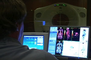 A radiologist at Shaw Regional Cancer Center examines a PET/CT scan.
