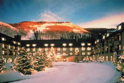 A view of the Vail Cascade front entrance with direct access to Vail Mountain in the background.