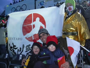 Nick and Max Williams chill out with Dad in front of Japanese ski-racing fans during the 2006 Winter Olympics men's slalom at Sestriere, Italy - a race won by Austria's Benjamin Raich.