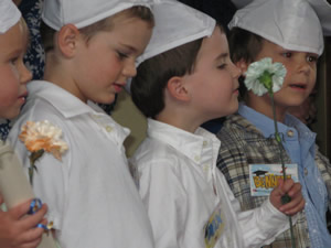 Max Williams, now 5, stops to smell the flowers during his Children's Garden of Learning graduation ceremony at Donovan Pavilion in Vail in June.