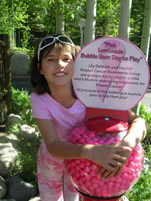 Lily DeMuth, 8, of Edwards, is raising money for breast cancer awareness with a bubble-gum machine she found abandoned in her mother's office.