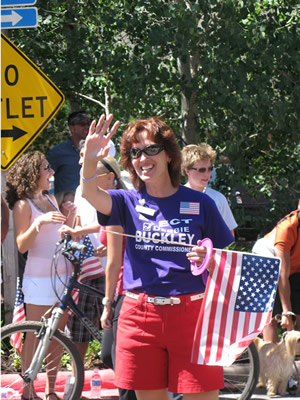 Eagle County commissioner candidate Debbie Buckley, of Avon, works the crowd Friday during the Vail America Days Fourth of July Parade in Vail.