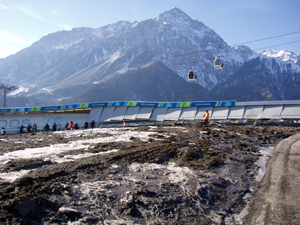 Global warming is a reality, not a debate, in Europe, where a decade�s worth of warming has left the Alps barren of snow in some places, often times year-round. The bobsled course at the 2006 Torino Olympics, shown above, was surrounded by mud, not snow, despite that it was one of the highest-altitude courses built in Olympic history.  A last-minute snowstorm allowed television crews to shoot their prescribed �snowy Alps� footage, but the snow barely lasted the length of the Games.