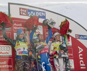 Julia Mancuso, left, was second in the opening Audi World Cup, with Italy's Denise Karbon, center, picking up the win.