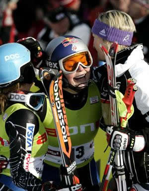 Vail's Lindsey Vonn is mobbed after winning the 10th World Cup race of her career Saturday in St. Anton, Austria.
