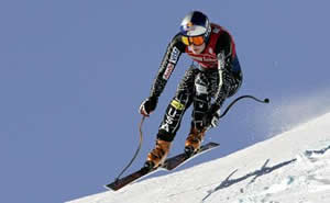 Lindsey Vonn charges to a women's downhill victory in St. Anton, Austria, Friday, the ninth World Cup win of her career.