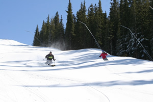 Skiers offer a preview of Copper Mountain's Nov. 7 opening with some fresh tracks down Copperopolis trail.