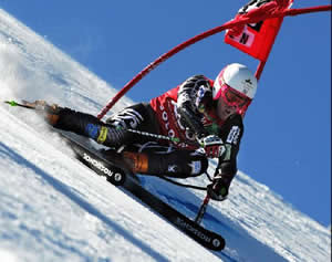 Ted Ligety, the 2006 Olympic combined gold medalist, charges to a third-place finish in Sunday's GS opener in Soelden, Austria.