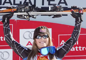 Ski Club Vail product Lindsey Vonn, 23, celebrates a downhill win Saturday on the men's speed course used during the 2006 Winter Olympics in Sestriere, Italy.