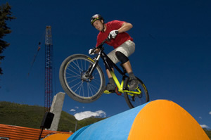 Conquering the hill at Teva Mountain Games. A beautiful day for the ups and downs at the mountain bike obstacle course.