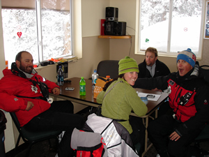 Gathered in a ski patrol hut at Wildwood on Vail Mountain