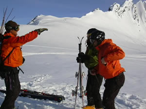 Alaska heli-skiing legend Dean Cummings, left, goes over some last-minute tips with clients who have gone to great lengths to reach the pinnacle of their sport.