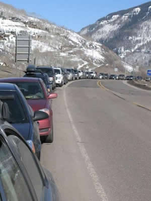 Cars line South Frontage Road on a recent weekday - another sign that day skiers are out in force in Vail. Critics of the new Epic Pass are afraid the traffic and parking woes will only get worse.