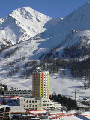 The spirit of the 2006 Winter Olympics shines through in this lovely photo from Sestriere, Italy, where the Games pulled in a cool $600 million in broadcast rights. Colorado wants some of that money in 2018. The below video shows the massive Italian Army security presence in Sestriere.